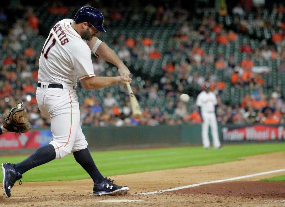 Houston Astros designated hitter Evan Gattis (11) makes move to catcher Photo: Elizabeth Conley, Houston Chronicle / © 2016 Houston Chronicle