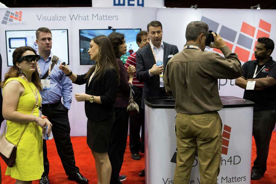 Guests visit the Optech4D booth at the Offshore Technology Conference and learn about uses of 3-D smart glasses. Photo: Marie D. De Jesus, Staff / © 2016 Houston Chronicle