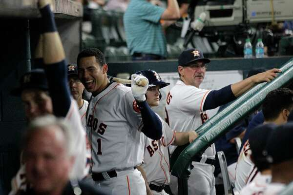 Houston Astros shortstop Carlos Correa (1) laughs at his teammates in the dugout in the eighth inning. Photos of game three between Houston Astros and Minnesota Twins on Wednesday, May 4, 2016, in Houston. Houston won the game 16-4.