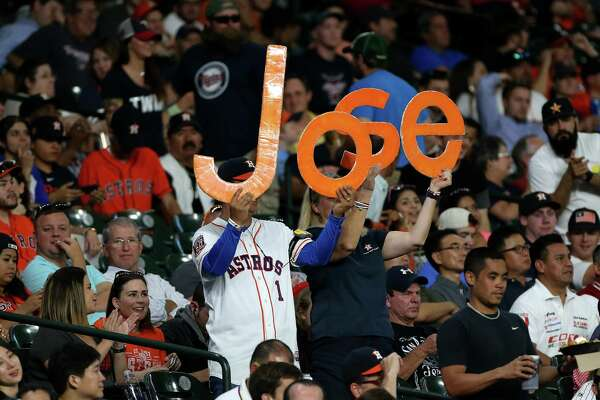 Fans hold up a sign for Houston Astros second baseman Jose Altuve (27) in the fifth inning. Photos of game three between Houston Astros and Minnesota Twins on Wednesday, May 4, 2016, in Houston. Houston won the game 16-4.