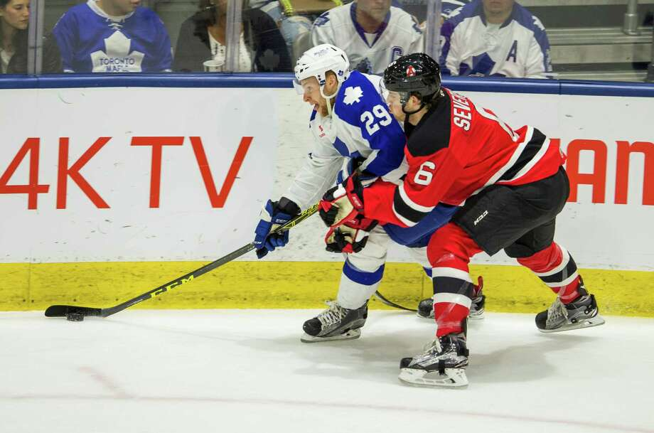 Toronto Marlies Connor Brown and Albany Devils Damon Severson during 1st period play off action at the Ricoh Coliseum in Toronto, Ont. on Wednesday May 4, 2016. Ernest Doroszuk/Toronto Sun/Postmedia Network Photo: Ernest Doroszuk / Postmedia Network