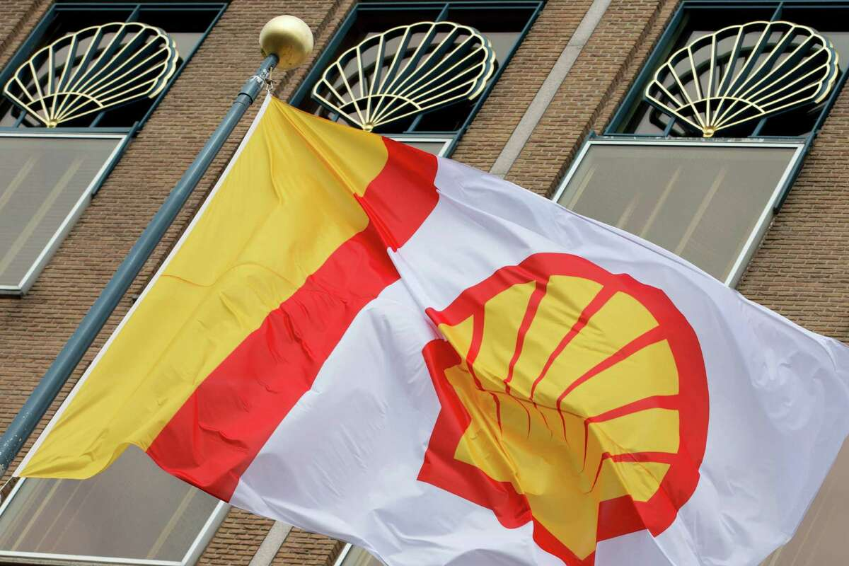 FILE - In this Monday, April 7, 2014 file photo, a flag bearing the company logo of Royal Dutch Shell, flies outside the head office in The Hague, Netherlands.