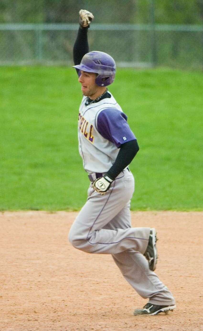 Westhill High School's Tyler Rich pumps his fist in the air in celebration after hitting a grand slam during a game against Staples High School in Stamford, Conn on April 16, 2010.