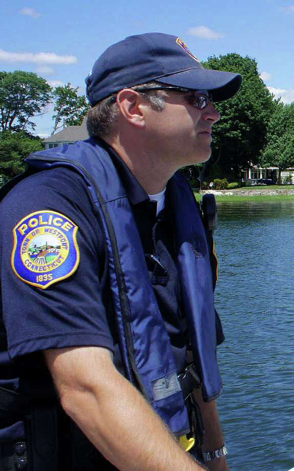 Police Sgt. Robert Myer, in a 2011 photo, on patrol as a member of the department's marine division. Photo: Westport News / File Photo / Westport News