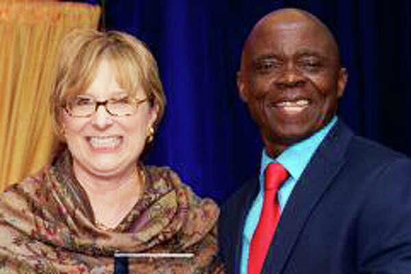Thomas Kitoko, of Fairfield, receives the 2016 Spirit of Inspiration Award from the Goodwill of Western and Northern Connecticut, presented by Vickie Volpano, CEO and president of the agency.