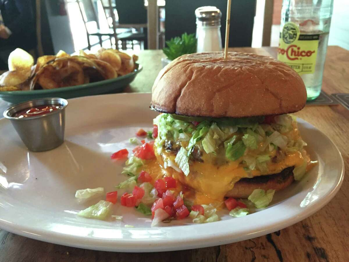 The Char King at Down on Grayson includes ground chuck, melted cheddar, mayonnaise, pickles, lettuce and tomato. It's served with a choice of fries or housemade chips.