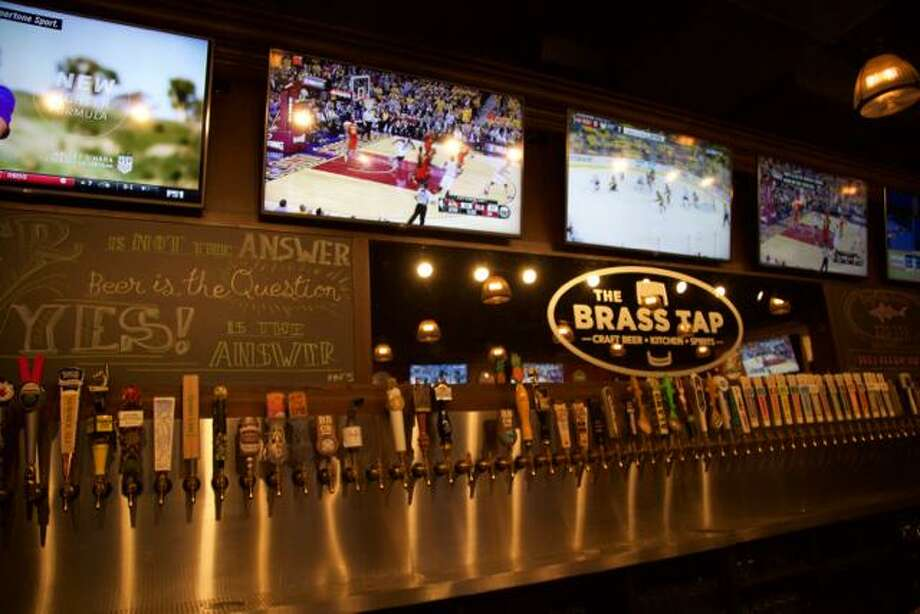 The Brass Tap, a restaurant and bar inside The Rim that featured more than 50 varieties of craft beer on tap, has filed for Chapter 7 bankruptcy and has ceased business operations. Photo: Express-News File Photo