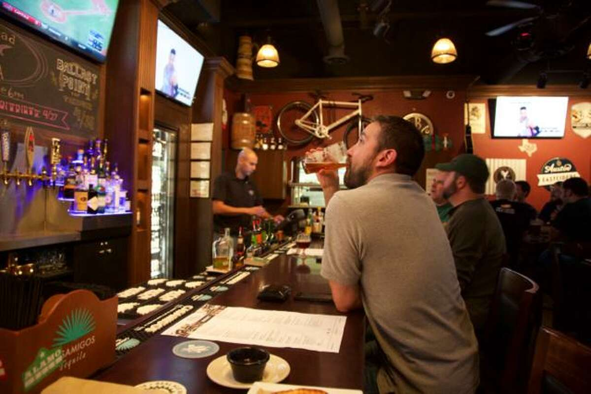 Rick Mancias enjoys a beer at The Brass Tap.