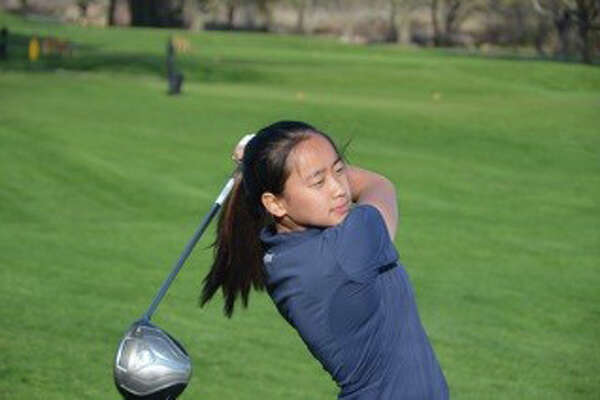 Staples' Anelise Browne takes a shot during a match this season. Browne shot a 37 in a match against Greenwich, which tied the school record for a female athlete.