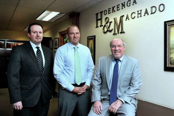 The Phil Spillane law firm, based in New Milford, recently merged with the Danbury based Hoekenga & Machado law firm. From left are, Attorneys Osvaldo Machado, Craig Hoekenga II and Phil Spillane, Monday, May 2, 2016.