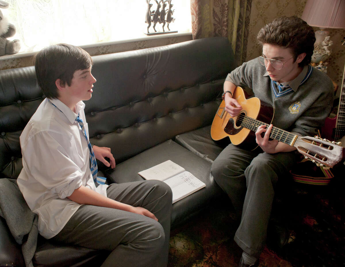 """Ferdia Walsh-Peelo, left and Mark McKenna in """"Sing Street."""" MUST CREDIT: The Weinstein Company"""