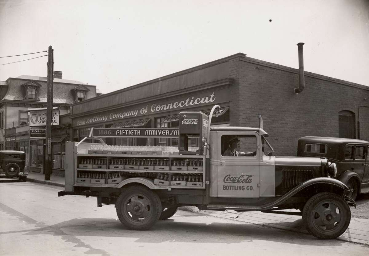 1936: A truck laden with bottles leaves the Coca-Cola Bottling Company of Connecticut premises on the 50th anniversary of the product.