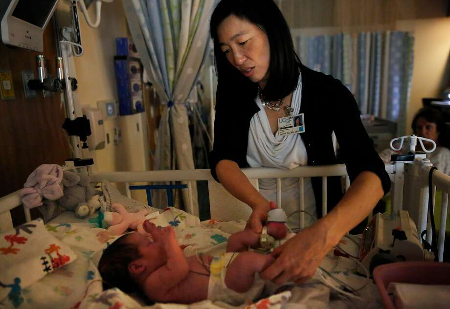 In this file photo, Dr. Yvonne Wu of UCSF Medical Center at Mission Bay examines a young patient in 2016. Columnist Caille Millner goes through a list of reasons of whether it's a good idea to have a kid in San Francisco. Photo: Leah Millis / The Chronicle