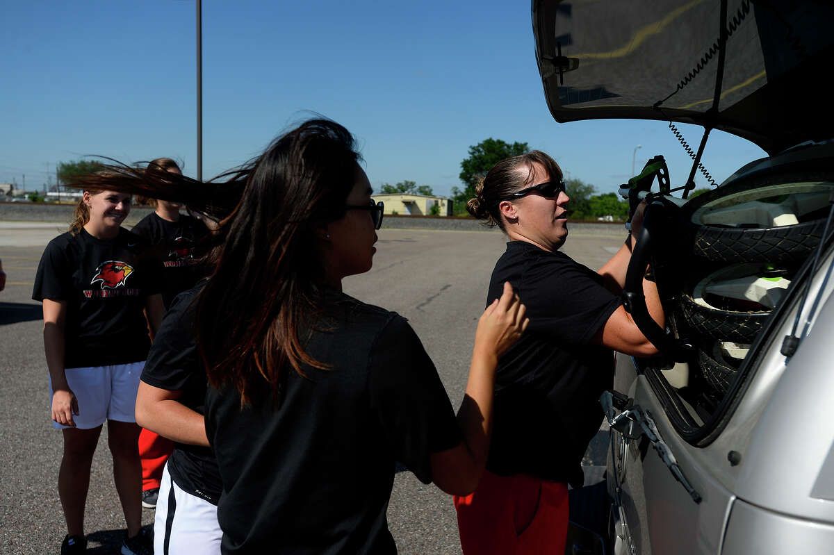 Lamar women's golf coach Jessica Steward helps pack as the team prepares to leave for Bryan to compete in the NCAA regionals on Tuesday afternoon. Photo taken Tuesday 5/3/16 Ryan Pelham/The Enterprise