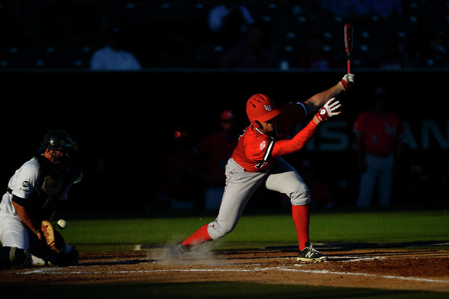 Lamar's Reid Russell swings at a low pitch against Rice on Wednesday evening.  Photo taken Wednesday 5/4/16 Ryan Pelham/The Enterprise Photo: Ryan Pelham / ©2016 The Beaumont Enterprise/Ryan Pelham