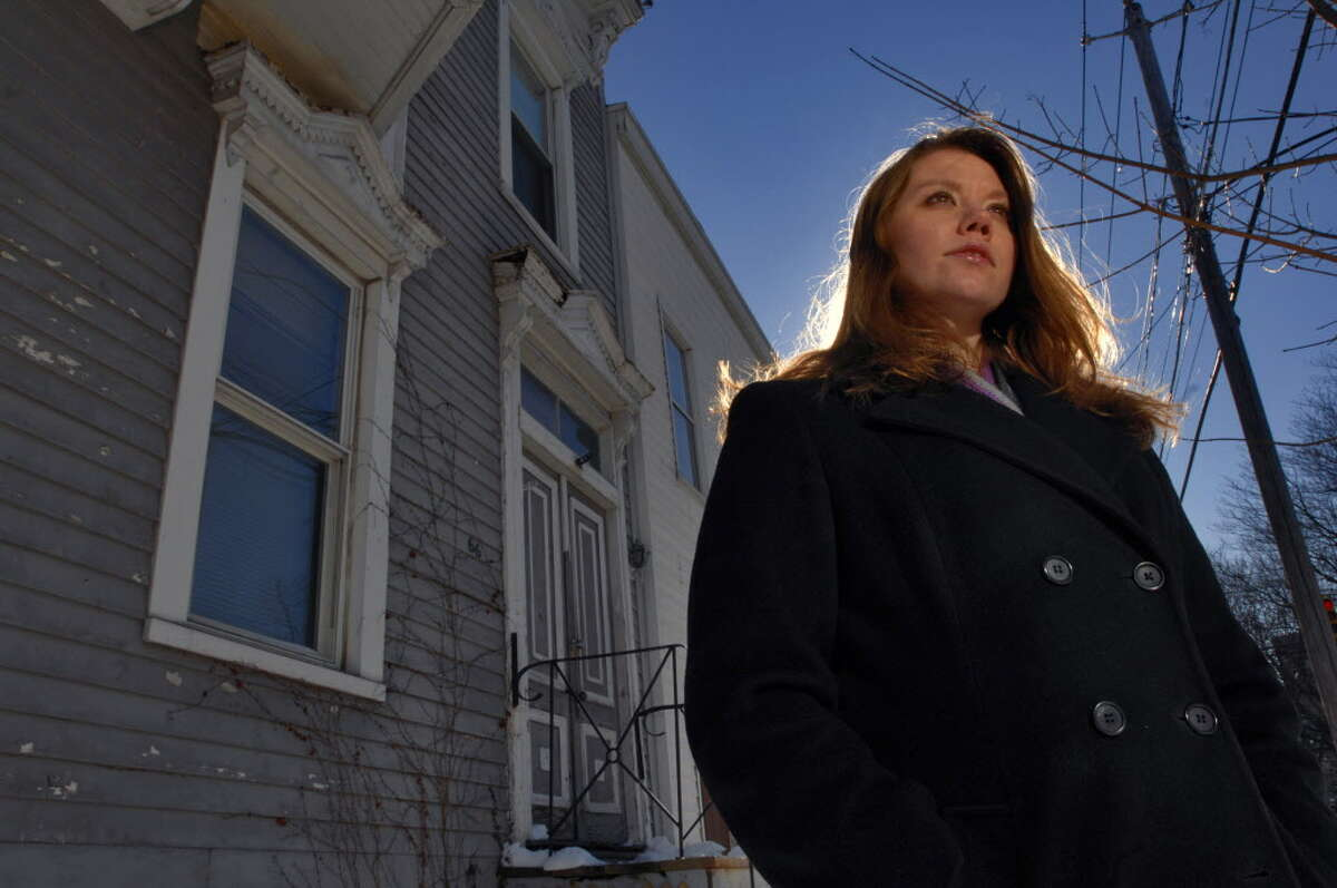 Times Union Staff photograph by Philip Kamrass -- Albany County assistant district attorney Jessica Blain-Lewis stands in front of 66 Ontario Street in Albany, NY on Monday February 19, 2007. She runs a narcotics eviction unit for the district attorney's office. The Ontario Street building was a target in the program.FOR MICHELE MORGAN BOLTON STORY.