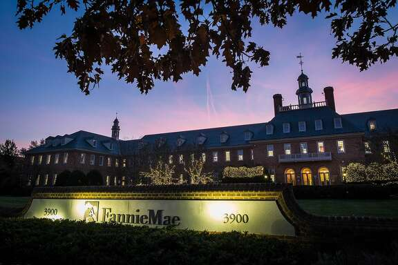 FILE - In this Nov. 20, 2013 file photo, the sun sets behind the Fannie Mae headquarters in Washington. Fannie Mae reports quarterly financial results before the market opens Thursday, May 7, 2015. (AP Photo/J. David Ake, File)