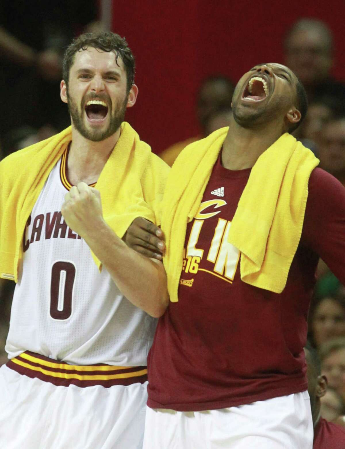 The Cleveland Cavaliers' Kevin Love (0) and Tristan Thompson celebrate on the bench after a third-quarter dunk by Richard Jefferson against the Atlanta Hawks in Game 2 of the Eastern Conference semifinals on Wednesday, May 4, 2016, in Cleveland, Ohio, at Quicken Loans Arena. The Cavs won, 123-98, to lead the series, 2-0.