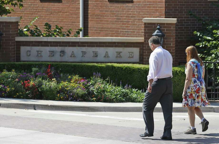 Chesapeake's sixth straight quarterly loss was driven by a $1.05 billion reduction in the value of the company's assets and $544 million in unrealized hedging losses, according to the statement. Photo: Associated Press /File Photo / Copyright 2016 The Associated Press. All rights reserved. This material may not be published, broadcast, rewritten or redistribu