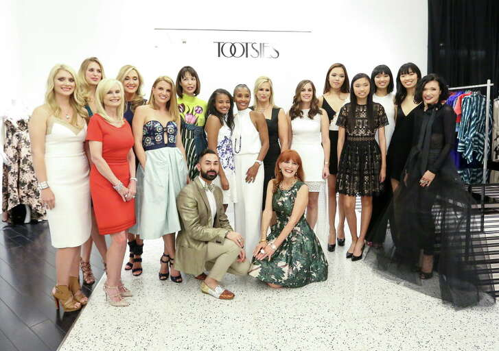 The moms and daughters pose with Fady Armanious, center-left, and Gracie Cavnar, center-right, after a fashion show at Tootsies