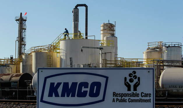 A worker at KMCO chemical processing plant climbs down from a storage tank Thursday, Dec. 3, 2015, in Crosby. Photo: Michael Ciaglo, Houston Chronicle / © 2015  Houston Chronicle