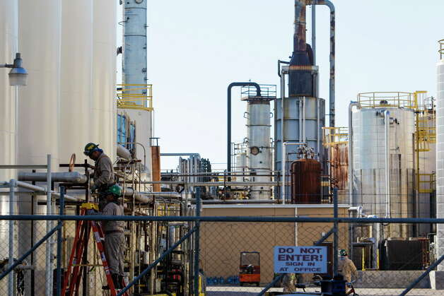 A worker at KMCO chemical processing plant inspects a pipe Thursday, Dec. 3, 2015, in Crosby. Photo: Michael Ciaglo, Houston Chronicle / © 2015  Houston Chronicle