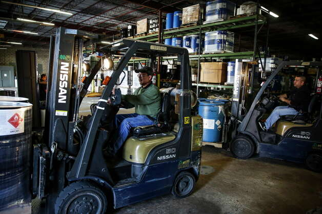 Forklift operator Francisco Rodriguez drives a pallet of toxic materials to a truck for transportation at Palmer Logistics Wednesday, Nov. 25, 2015, in Houston. Photo: Michael Ciaglo, Houston Chronicle / © 2015  Houston Chronicle