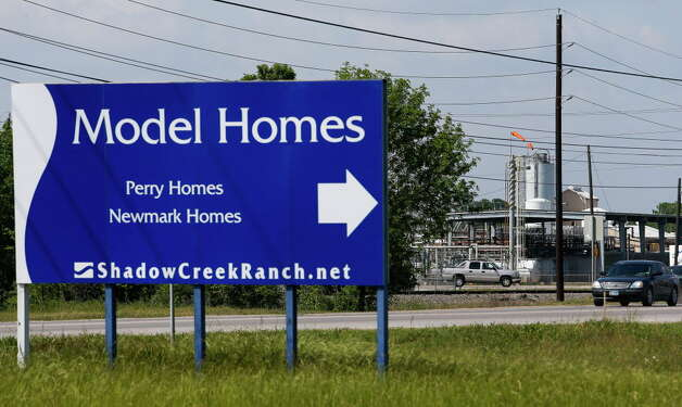 A sign for new homes sits across from Akzo Nobel Surface Chemistry, one of the businesses on the list of high harm facilities Thursday, April 14, 2016 in Houston. Photo: Michael Ciaglo, Houston Chronicle / © 2016  Houston Chronicle