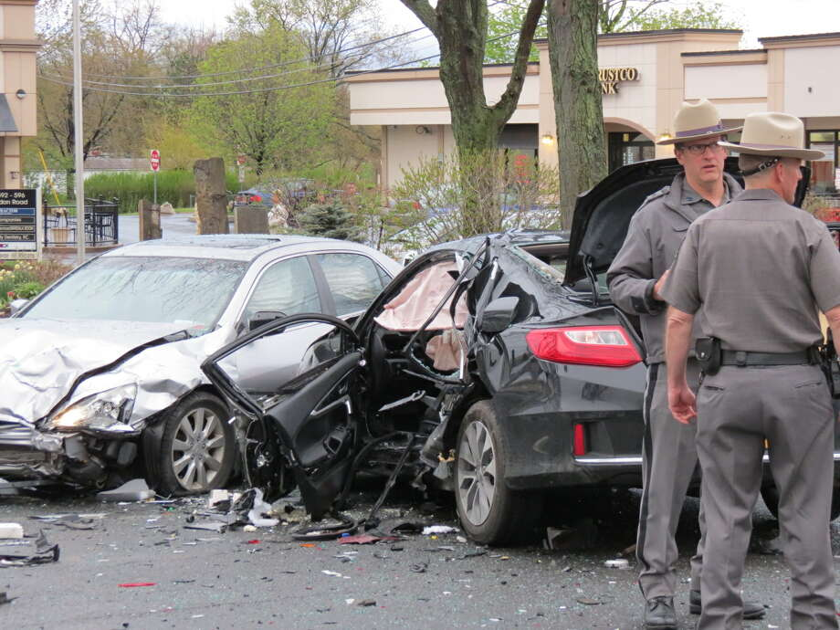A 21-year-old Troy man and two of his passengers were hospitalized Wednesday after causing two separate crashes on Loudon Road after fleeing State Police, troopers said.(Tom Heffernan Sr. / Special to the Times Union)