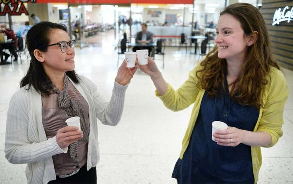 Shiela Miller and Leila Novakowski toast as they take the Albany County Tap Water Taste Test at Empire State Plaza on Thursday, May 5, 2016. (John Carl D'Annibale/Times Union)