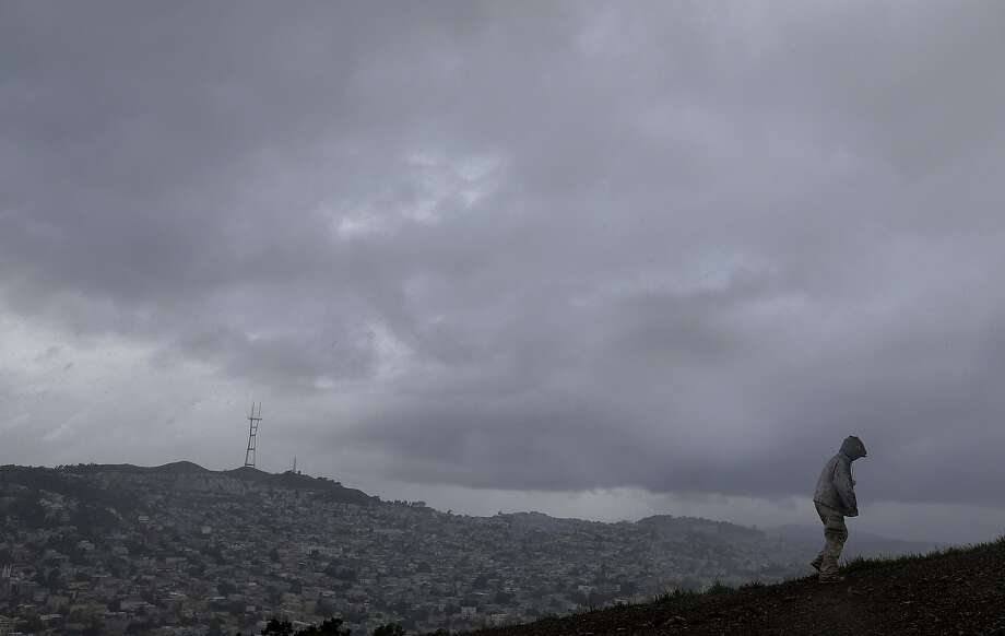 A man walks in rain and hail on Bernal Heights Hill in San Francisco on March 7. Thunder crashed and lightning struck ThursdayMay 5, 2016in parts of the region. Photo: Jeff Chiu, AP