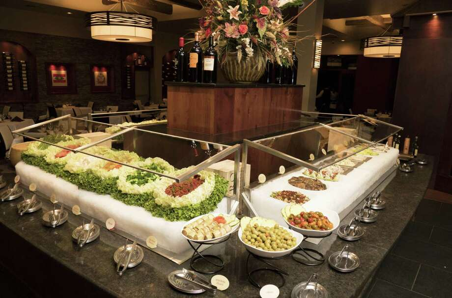 The apple salad at Chama Gaúcha Brazilian Steakhouse is one of the features of the large and ornate salad bar. Photo: Billy Calzada /San Antonio Express-News / San Antonio Express-News