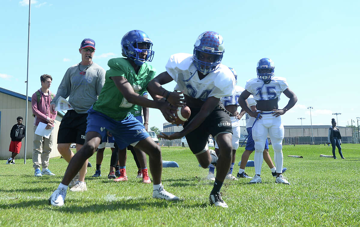 West Brook's varsity players work drills on the opening day of spring football practice Wednesday. The early practice gives the 6-A Bruins a step forward in determining this season's starters, especially after graduating a number of key players this year. Photo taken Wednesday, May 4, 2016 Kim Brent/The Enterprise