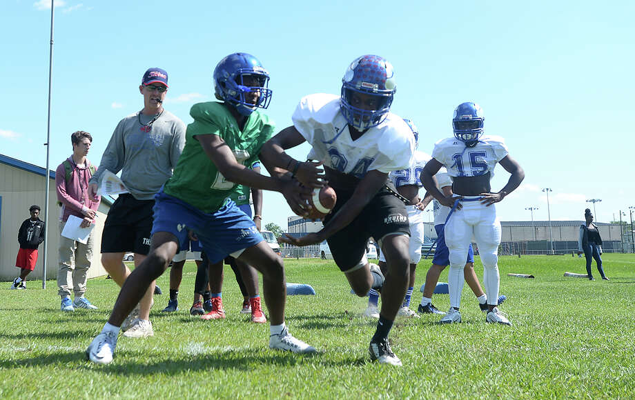 West Brook's varsity players work drills on the opening day of spring football practice Wednesday. The early practice gives the 6-A Bruins a step forward in determining this season's starters, especially after graduating a number of key players this year. Photo taken Wednesday, May 4, 2016 Kim Brent/The Enterprise Photo: Kim Brent / Beaumont Enterprise