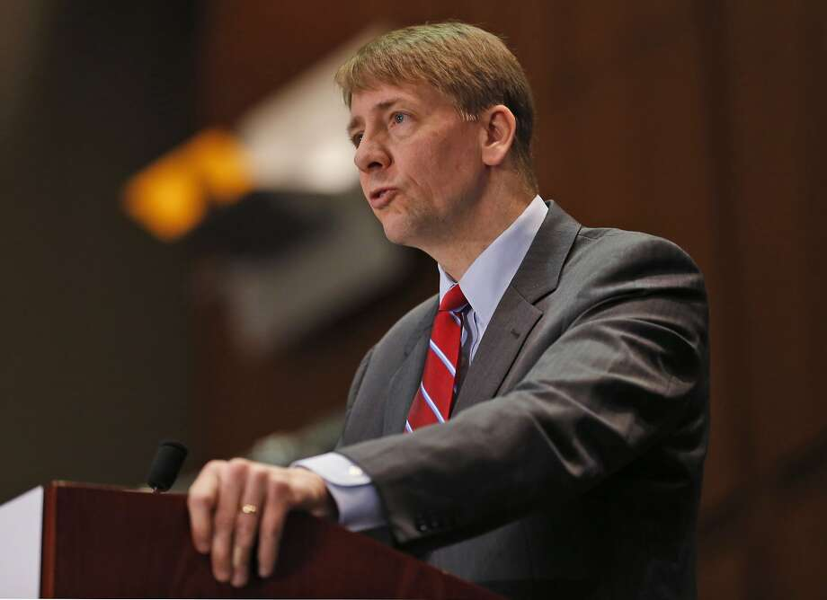 FILE - In this March 26, 2015, file photo, Consumer Financial Protection Bureau (CFPB) Director, Richard Cordray, speaks during a panel discussion in Richmond, Va. The CFPB is considering banning a practice known as forced arbitration for financial services. (AP Photo/Steve Helber, File) Photo: Steve Helber, Associated Press