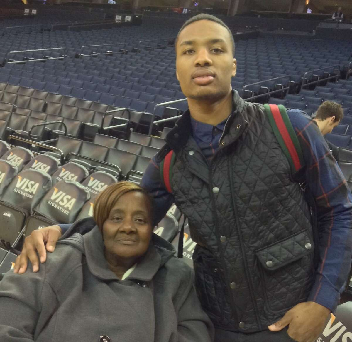 Portland Trailblazer and Oakland native Damian Lillard is seen with his grandmother, Cecelia Johnson, at Oracle Arena in Oakland.