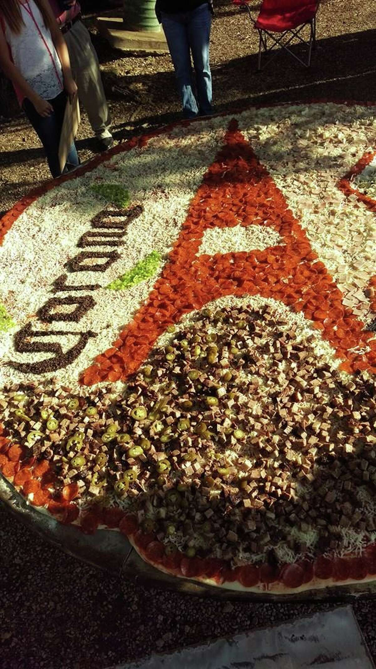 Kurt Oefinger, owner of Hondo-based Dirt Road Cookers, makes gigantic pizzas which measure 8 feet in diameter.