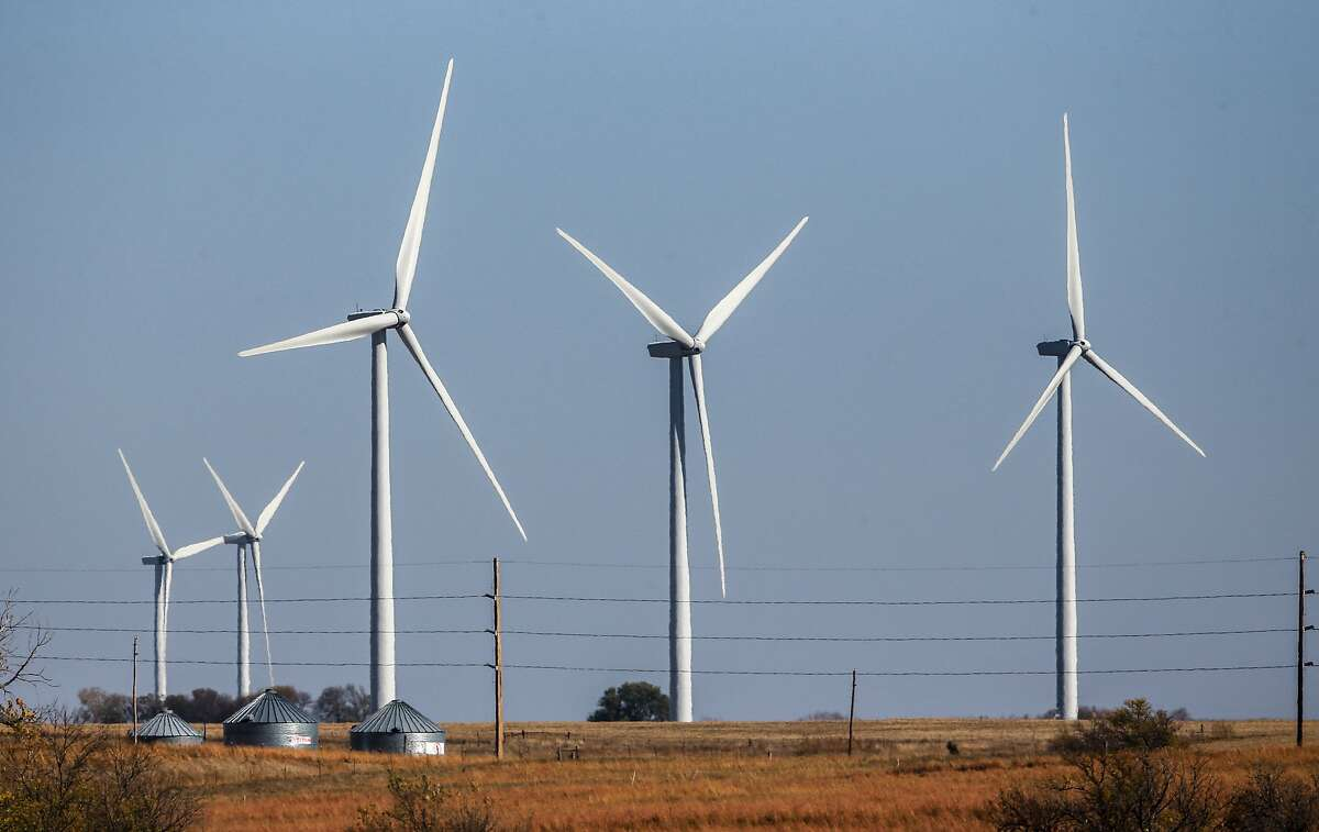 In this photo from Nov. 3, 2015, wind turbines dot the landscape near Steele City, Neb. Renewable energy advocates say they're encouraged by a new push to expand wind energy in Nebraska, which lags many of its neighboring states when it comes to tapping the resource. (AP Photo/Nati Harnik)