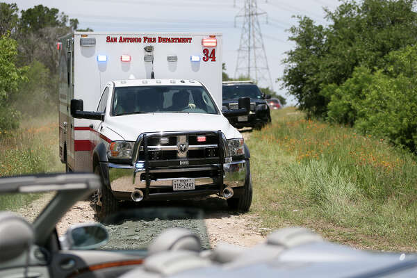 An ambulance cayying Emanuel Gregory Martinez leaves the Martin Marietta Beckman Quarry on NW Military Hwy north of Loop 1604 W on Thursday, May 5, 2016 Highway, 2016. Martinez was the subject in a car hijacking attempt on the South Side who led police on a chase that ended at the quarry.  He was shot by the police before being apprehended.   MARVIN PFEIFFER/ mpfeiffer@express-news.net