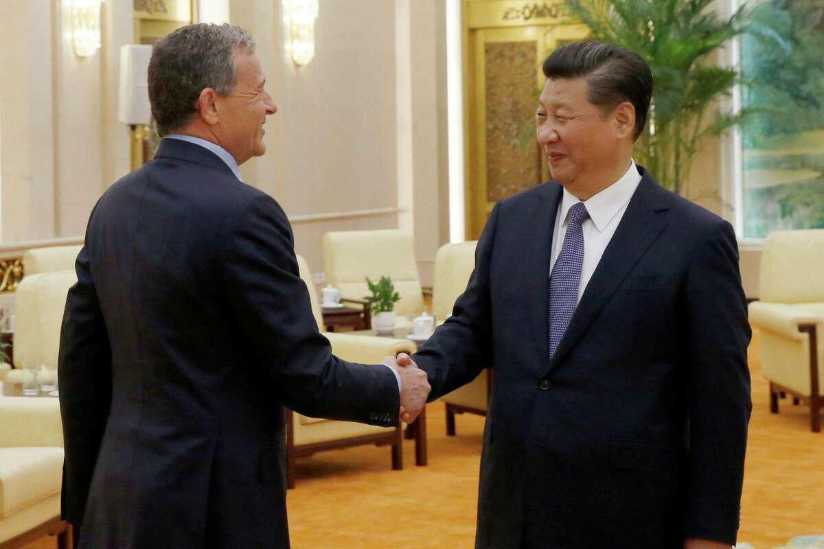China's President Xi Jinping, right, talks with CEO of the Walt Disney Company Bob Iger as they meet at the Great Hall of the People in Beijing, China, Thursday, May 5, 2016. (Kim Kyung-hoon/Pool Photo via AP) ORG XMIT: TKMY301