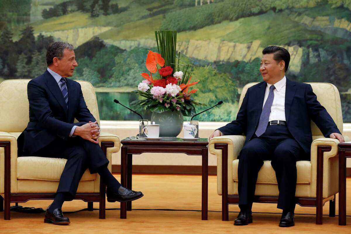 China's President Xi Jinping, right, talks with CEO of the Walt Disney Company Bob Iger at the Great Hall of the People in Beijing, China, Thursday, May 5, 2016. (Kim Kyung-hoon/Pool Photo via AP) ORG XMIT: TKMY303