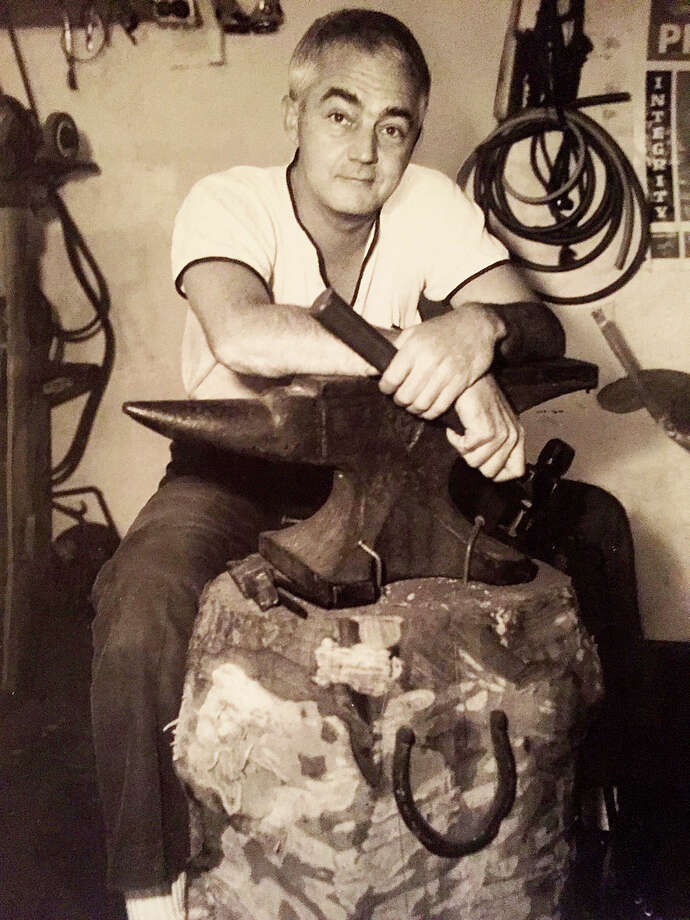 Artist Howard Munce at work in the 1960s. Photo: Contributed Photo / Westport News