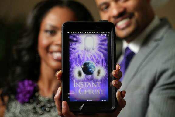 """Donald and Cenaca Cyprian founded Instant Christ, a Christian social media platform. """"What it's designed to do is to connect the body of Christ worldwide,"""" Donald Cyprian said. About 2,000 people have downloaded Instant Christ so far.   ,"""