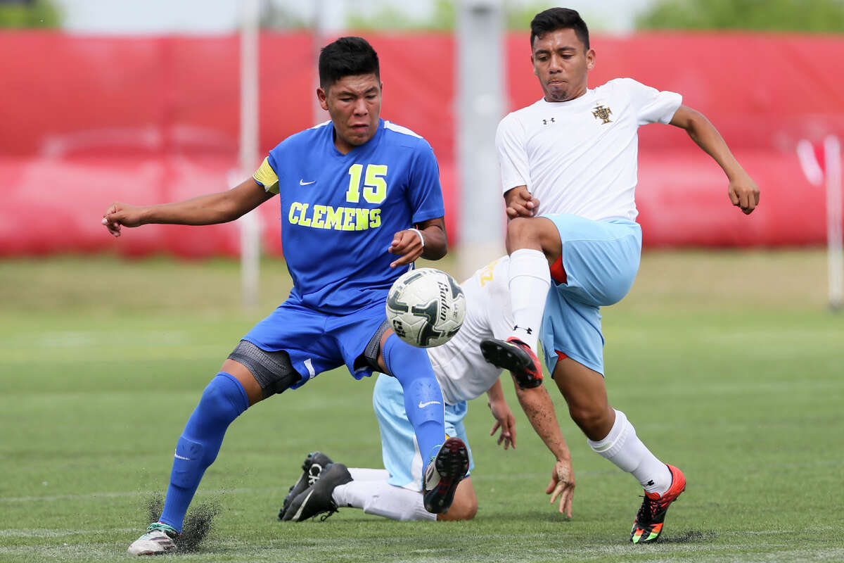 Clemens' Michael Maldonado (left) fights for the ball with Brownsville Lopez's Ruben Sauceda during the second half of their Region IV-6A semifinal match at the Brownsville Sports Park on April 8, 2016.