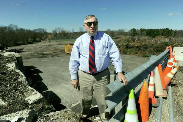 Fred Hurley, Newtown's director of public works, stands in front of the area of land where Newtown hopes to build a solar farm, Wednesday, April 13, 2016.