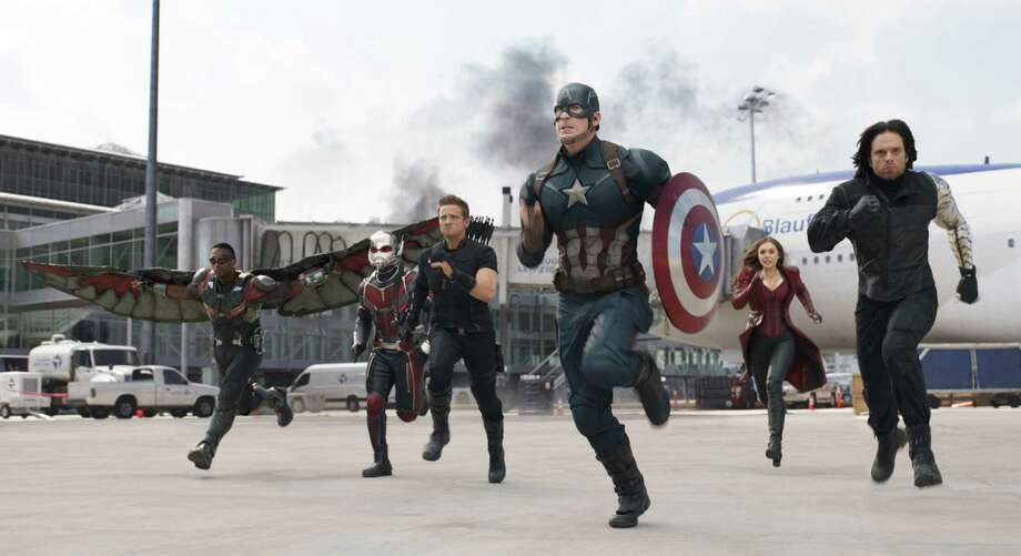 "In this image released by Disney, Anthony Mackie, from left,  Paul Rudd, Jeremy Renner, Chris Evans, Elizabeth Olsen and Sebastian Stan appear in a scene from ""Captain America: Civil War."" (Disney-Marvel via AP) ORG XMIT: NYET123 / Disney-Marvel"
