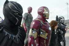 "This image released by Disney shows, from left, Chadwick Boseman as Panther, Paul Bettany as Vision, Robert Downey Jr. as Iron Man, Scarlett Johansson as Natasha Romanoff, and Don Cheadle as War Machine in a scene from ""Marvel's Captain America: Civil War."" (Disney Marvel via AP) ORG XMIT: NYET350"