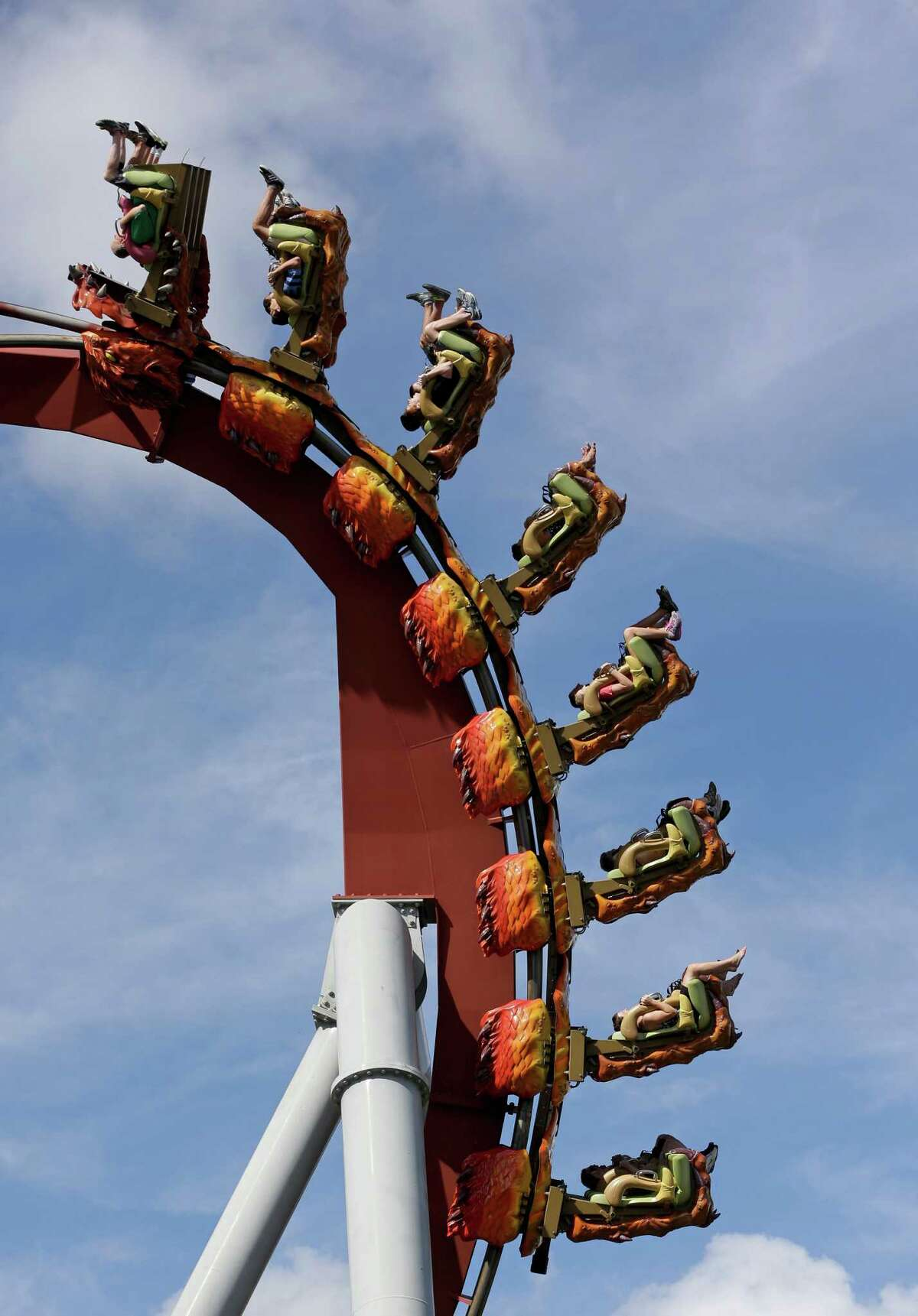 Park guests ride the Dragon Challenge roller coaster at Universal Studios in Orlando, Fla.