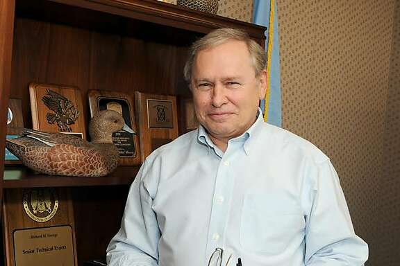 "Richard ""Dickie"" George, a former NSA employee, in his office at the agency."