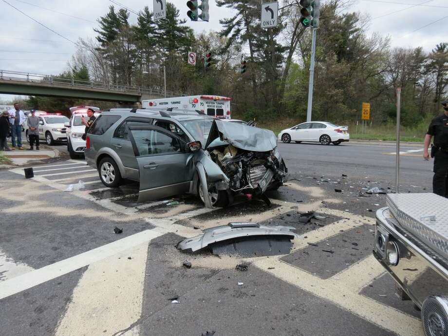 A Latham woman in her 80s was killed and the driver of the car critically injured when their car collided with a CDTA bus Thursday afternoon on the Northway near the Crossgates Mall ramp. (Tom Heffernan Sr. / Special to the Times Union) Photo: Picasa